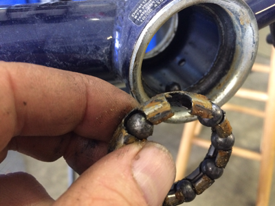 Worn bearing from the bottom bracket of a Schwinn Bicycle with a one peice crank. Circuit Cycle and Sports