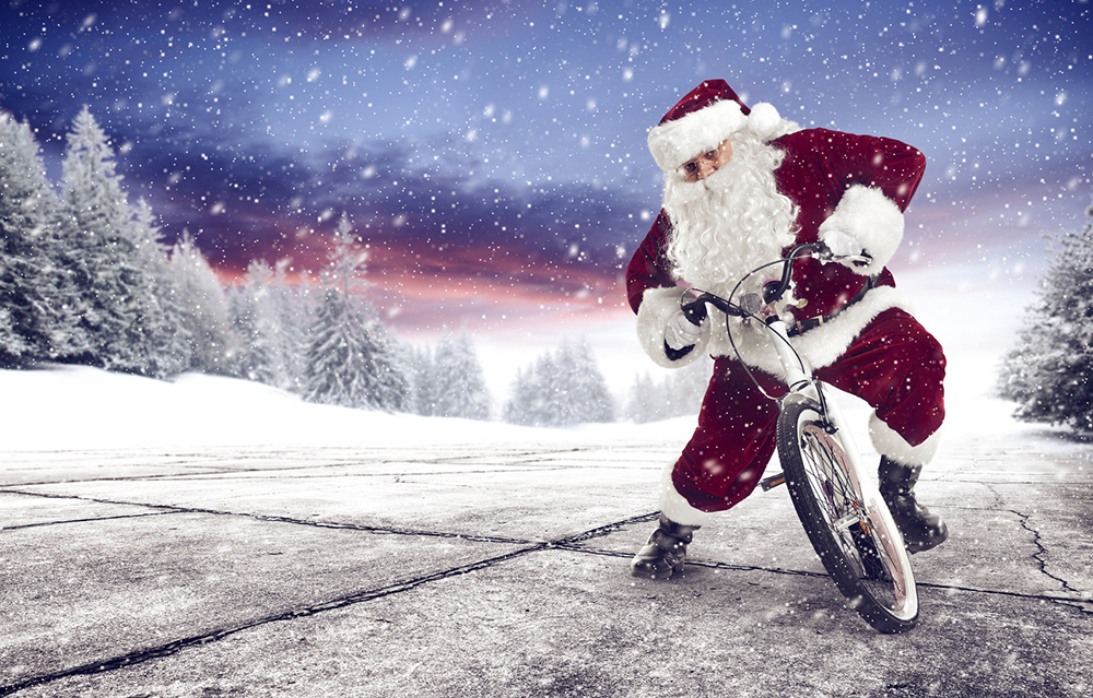 Santa riding bicycle